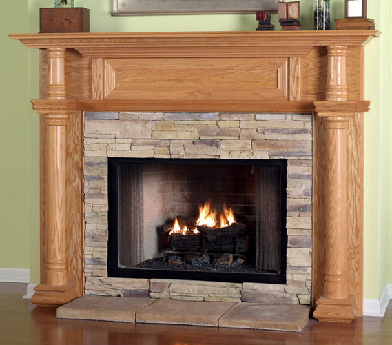 The Chapman fireplace mantel  has a wood framed top panel.