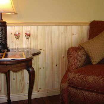 Use V-grooved knotty pine planking as wainscoting with a chair rail