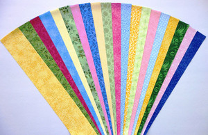 "Pink, Blue, Yellow, Green Fabric Jelly Roll Strip Pack -20 Strips, Die Cut, No Duplicates. 4 Colors, 5 Strips of each color ranging in value from light to dark 100% top quality cotton fabric. 20 Different fabrics, 1 strip of each. Strips measure 2.5"" x width of fabric (42/44"" approx). Strips are folded and shipped flat."