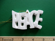 "White plaster ornament - ""Peace"" - ready for painting. Includes gold hanging cord - 3"" approx"
