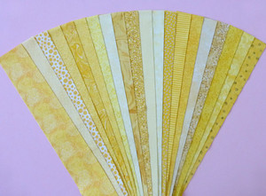 """Yellow Fabric Jelly Roll Strip Pack -20 Strips, Die Cut, No Duplicates. 100% top quality cotton fabric. 20 Different fabrics, 1 strip of each. Strips measure 2.5"""" x width of fabric (42/44"""" approx). Strips are folded and shipped flat."""