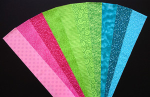 "COTTON CANDY Pink, Green, Teal / Turquoise Fabric Jelly Roll Strip Pack -20 Strips, Die Cut 100% top quality cotton fabric. 10 Different fabrics, 2 strips of each. Strips measure 2.5"" x width of fabric (42/44"" approx). Strips are folded and shipped flat."