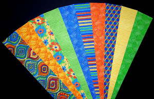 "MARDI GRAS Fabric Jelly Roll Strip Pack -20 Strips, Die Cut 100% top quality cotton fabric. 10 Different fabrics, 2 strips of each. Strips measure 2.5"" x width of fabric (42/44"" approx). Strips are folded and shipped flat."