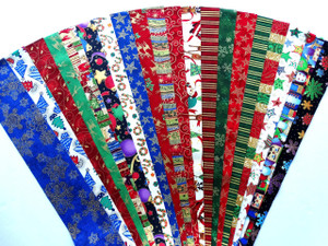 """20 Different Christmas Fabrics with Metallic Highlights in Every Strip 100% top quality cotton fabric. 20 Different fabrics, 1 strip of each. Strips measure 2.5"""" x width of fabric (42/44"""" approx). Strips are folded and shipped flat."""