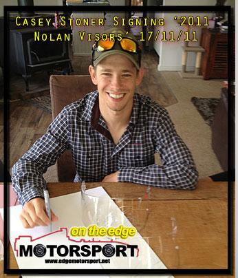 casey-stoner-signed-2011-nolan-helmet-signing.jpg