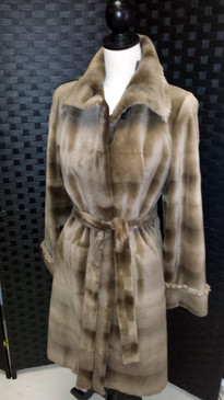 Dark beige sheared mink with fringe trim, reversible to silk