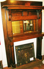 Antique Arts & Crafts quartersawn oak full mantel with beveled mirror and two flat panels.