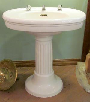 "Gorgeous Colonial Revival Style vitreous china oval topped pedestal sink  made by ""SESCO"" featuring a fluted column pedestal."