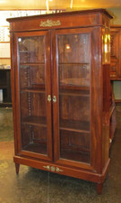 Elegant mahogany display cabinet that could be used as a bookshelf, a cupboard, or curio cabinet.