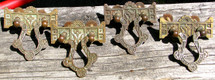 Set of four cast bronze Eastlake style drawer pulls