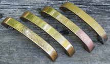Mixed set of four brass pulls