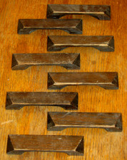 Eight antique oak furniture pulls