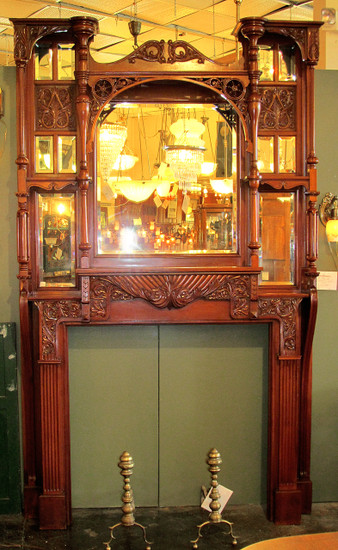 Spectacular Late Victorian carved cherry fireplace mantle with a total of eleven beveled mirrors and its original finish.