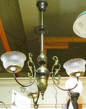 Full view of antique fixture and shades made by Duncan and Miller