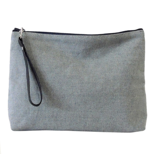 Carryall Clutch in Reverse Denim, with wrist strap