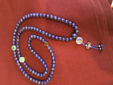 Lapis lazuli blue mala with sacred image resting beads, 8mm.