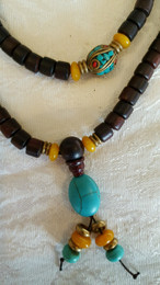 Dark Rosewood Mala, oval shaped turquoise guru bead accent with resting bead