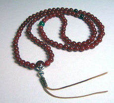 Carnelian natural stone Mala crafted from 8 mm beads, then strung on a strong, durable cord, with 2 Black Onyx stone spacers and a cut Green Jade stone spacer in between sterling silver rings.