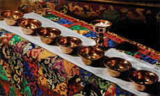 Offering bowls are used on shrine tables for making water offerings expressing generosity.  Set includes a butter lamp. Perfect for your shrine table to make water offerings.