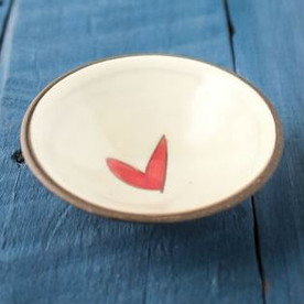 ceramic cream colored dish with red/pink heart