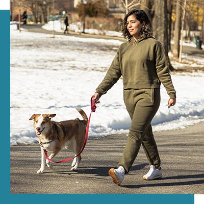 Image of woman walking her dog.
