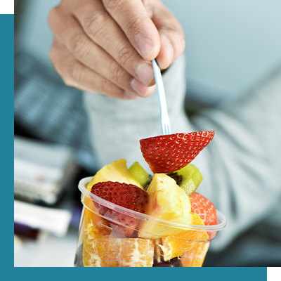 Image of a man eating a healthy snack.