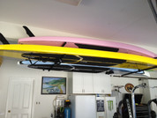 Premium Quality Stand up Paddle Board Ceiling Racks. T-Rax Surf Racks are Available with Different Length Support Bars for Longboards and Shortboards.