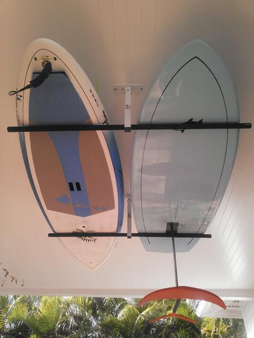 """T-Rax Ceiling Rack shown with the 28"""" SUP support bars. Stand Up Paddleboards nice and safe on the ceiling."""