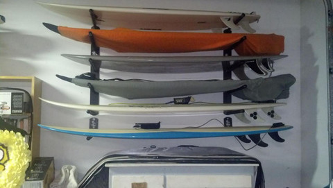 T-Rax Five Board Surf Rack shown  Mounted Above a Single Board Rack.  Surf racks are available in five different colors.