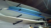 T-Rax Surfboard Rack Easily Handling a Longboard and Wave Storm Soft Top Board.  At T-Rax we build our surf racks strong, no plastic or wood used. Only high quality military grade aluminum used in the construction of our surf racks.