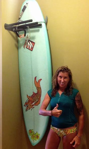 Awesome Kellie right after she mounted her Hang'em High Double surf rack. She mounted these wall racks in her home and they fit nicely in the tight spot she had available.