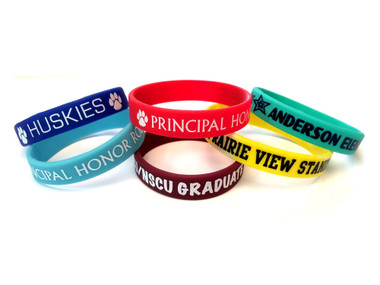 Shown are imprinted wristbands from Cool School Studios (4010).