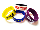 Shown are imprinted wristbands from Cool School Studios (4008).