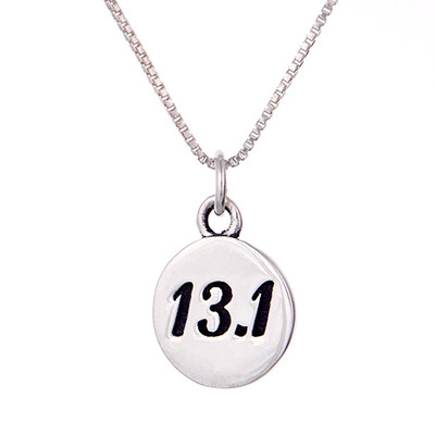 13.1 round charm on a sterling silver box chain.