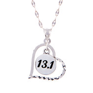 13.1 round charm inside a heart hanging on from a star chain.