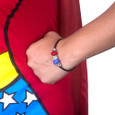 Close-up of model wearing Wonder Woman European bracelet and matching Wonder Woman Running costume