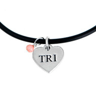 Cute TRI heart necklace on a black rubber code an a cute coral gem stone drop.