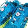 Sneakers with 19.3 and Believe shoelace charms on them