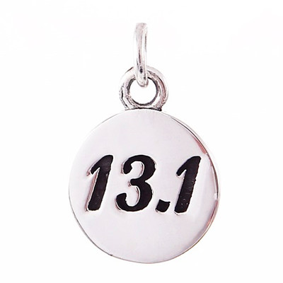 Round sterling silver 13.1 charm.