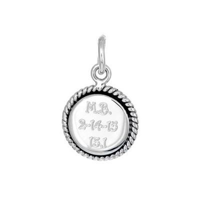 Small round charm with race name, date and distance engraved on it.