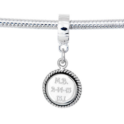 Custom engraved round charm in sterling silver with engraving for race name, distance and date. hangs on a silver charm carrier.