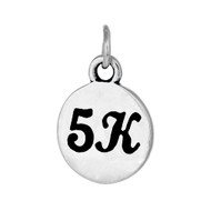 round sterling silver 5K charm.