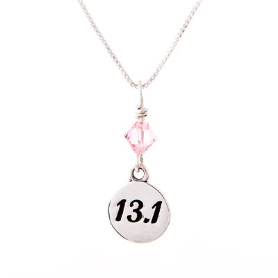 13.1 round charm with a pink crystal on a box chain necklace.