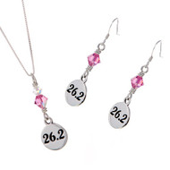 26.2 round sterling silver charm on a box chain and matching earrings.