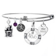 Dopey Distance 48.6 Bangle with engraved charm and castle charm.