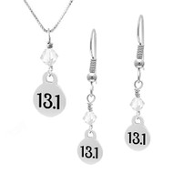 13.1 mini charm and crystal necklace and earring sets.