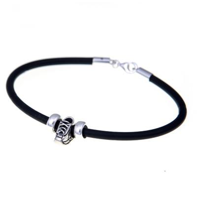 European rubber bracelet featuring a sterling silver running shoe bead.