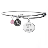 Sterling Silver Personalized engraved oval charm on bangle bracelet.