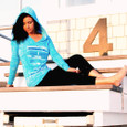 Running is.. Tahiti Blue Hoodie on model sitting on lifeguard stand.