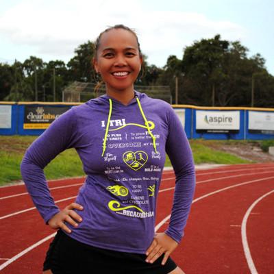 Model wearing Purple with yellow print I TRI Triathlon hoodie.